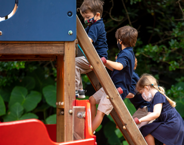 Kids playing outside during Stay at Fay