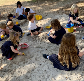 At Stay at Fay, kids get to play outside in the sandbox!