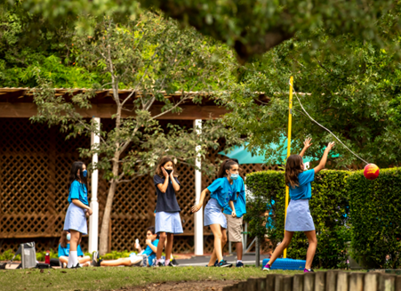 Girls playing tether ball at Stay at Fay